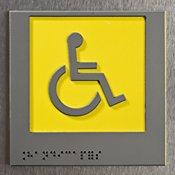 Panneau handicapé en relief et avec écriture braille